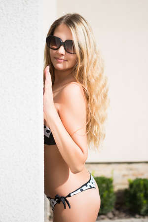 Nice blond woman in swimsuit posing outdoors Stock Photo