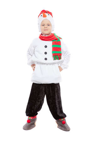 Little adorable boy in a snowman costume posing in studio on an isolated white background