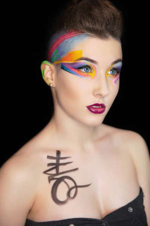 Young sexy woman with creative make up and body painting