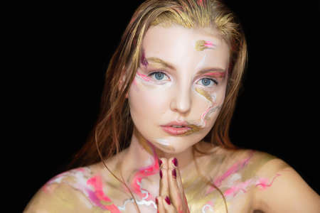 Portrait of a young woman with creative make up on her face