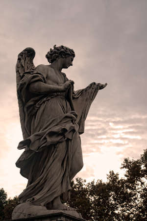 metropolis image: Sculpture of an angel carved in marble, Rome