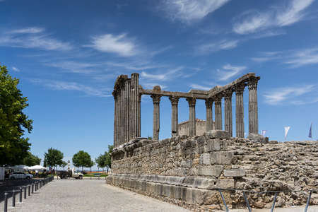 Walking through the streets of the historic city of Evora in Portugal Stock Photo