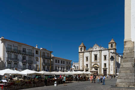 Walking through the streets of the historic city of ? ? vora in Portugal