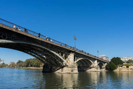 town planning: The river Guadalquivir over the bridge of Triana in Seville