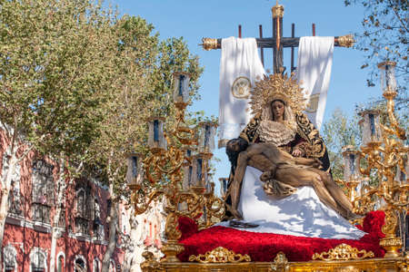 seville: brotherhood of Marketplace, Holy Week in Seville Stock Photo