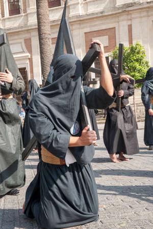 brotherhood: Penitente con su cruz, Semana Santa de Sevilla Nazareno de la Hermandad de los estudiantes