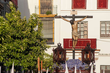 crossings: Brotherhood of the Negritos, Holy Week in Seville Stock Photo