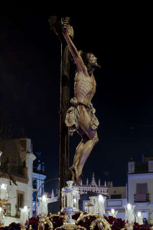 Jesus dying on the cross, Holy Week in Seville, the Brotherhood of the Puppy