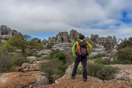 The hiker who admire the rocky landscape of El Torcal de Antequera, Andalucia