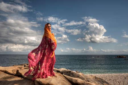 Beautiful Woman in Arabic by the sea