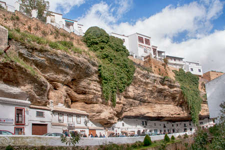 Typical streets of the town of Setenil of Bodegas in the province of Cadiz, Andalusia, Spain Редакционное