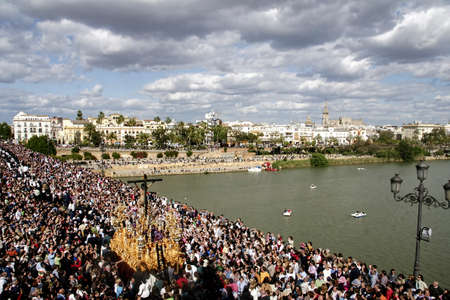Brotherhood of the puppy going through the bridge of Triana, Holy Week in Seville