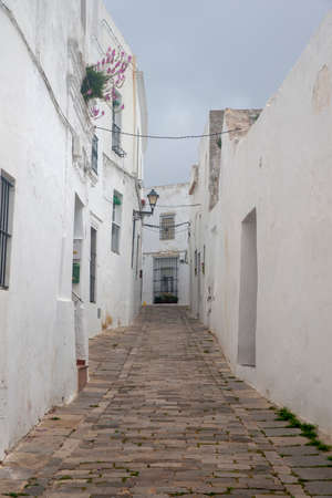 Street in the town of Vejer de la Frontera and one of the so-called white towns of Andalusia Stock Photo