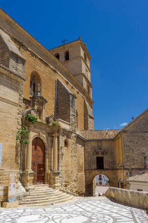 walk along the street of the church in the municipality of Alhama de Granada, Andalusia Фото со стока