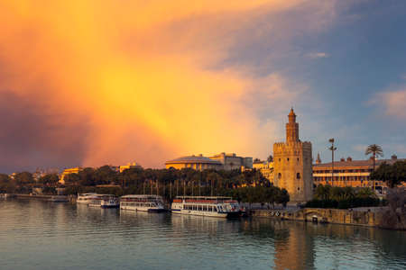Golden Tower next to the Guadalquivir River in the city of Seville, Spain Фото со стока