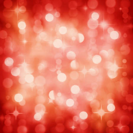 Background of defocused red lights with sparkles. Christmas, New Years, disco party.