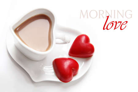 Valentine s Day morning coffee with red heart chocolates on white background Stock Photo