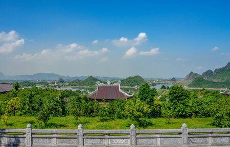 Angle view from The complex of Bai Dinh Pagoda Buddhist temples with blue sky and clouds on Bai Dinh Mountain in Gia Vien, Ninh Binh, Vietnam