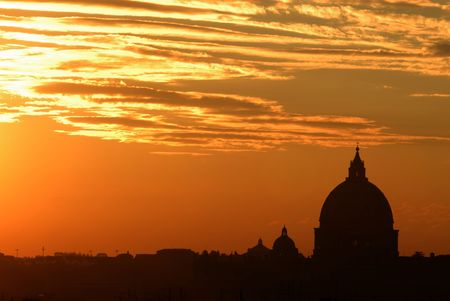 Beautiful colors in Rome at sunset with the Saint Peter Basilica silhouette photo