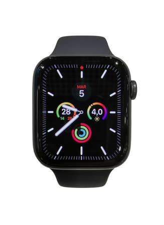 Apple watch series 5 44mm Space Gray Aluminum Case with Black Sport Band in a consumer electronics store with default colorful informative display always lit