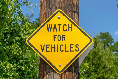 Watch For Vehicles Street Sign 스톡 콘텐츠