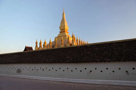 Pha That Luang is a large gold-covered Buddhist stupa in the centre of Vientiane, Laos Stock Photo