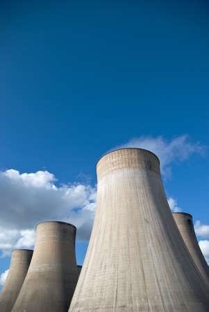 power station: Cooling Towers of a coal fired power station against blue sky Stock Photo