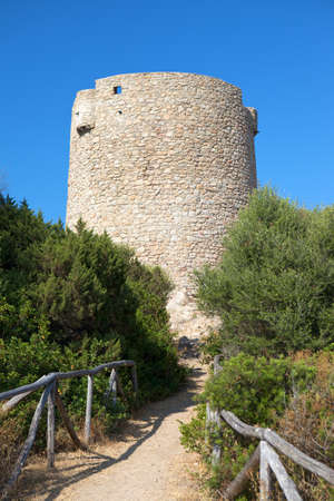 Ancient Spanish tower at Vignola Mare Stock Photo