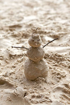 Christmas on the beach with a snowman made of sand