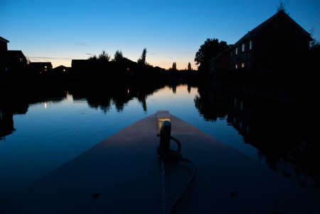 Traveling along a canal at twilight