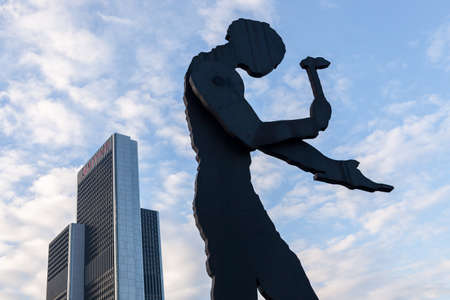 The sculpture, Hammering Man, by Jonathan Borofsky near Frankfurt Messe exhibition area is a mechanical construction with periodicaly moving arm holding hammer. Stock Photo