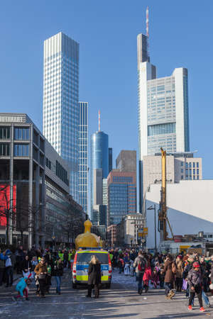 The end of a parade heads downtown towards many of the skyscrapers in Frankfurt.
