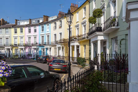 Victorian terraced houses neatly painted in pastel colours