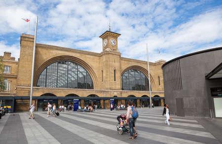 Kings Cross Railway Station London with people walking outside. Editorial
