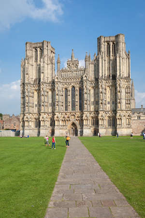 Exterior of Wells Cathedral with unidentified people is the seat of the Bishop of Bath and Wells. Stock Photo