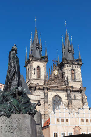 The Jan Hus Statue looks up to Tyn Church, Old Town Square, Prague, Czech Republic Stock Photo