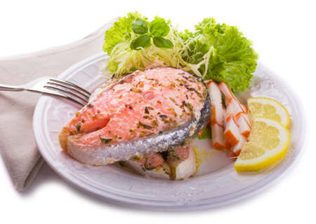 Flakey delicious salmon with herbs  served with lemon and a healthy light salad