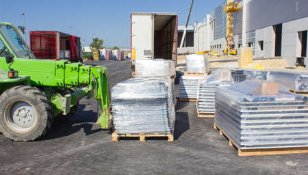 Forklift loading pallets in warehouse photo