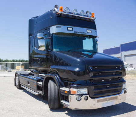 oversize load: Black truck