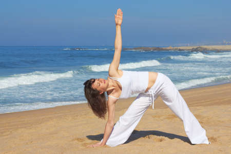 Yoga on the beach in summer day photo