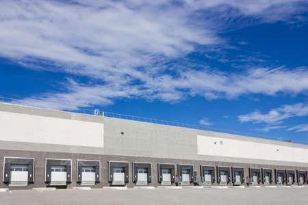 loading bay: Loading dock cargo doors at big warehouse