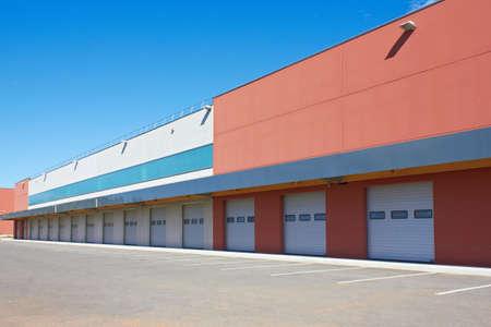 loading bay: cargo doors at big warehouse