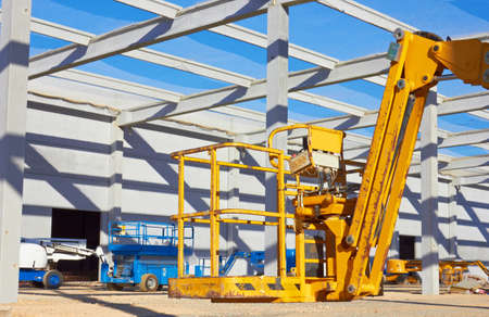 Hydraulic mobile construction platform elevated towards a blue sky