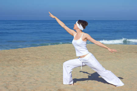 Yoga on the beach in summer day Stock Photo - 18151223