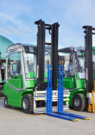 fork lift trucks with raised fork, front view photo