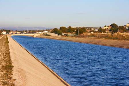 waterway: water flowing in an irrigation canal in France Stock Photo