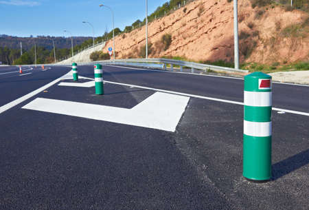 diversion: Fence on the highway, diversion signs  Stock Photo