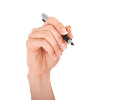 hand holding pen: Woman hand with a pen
