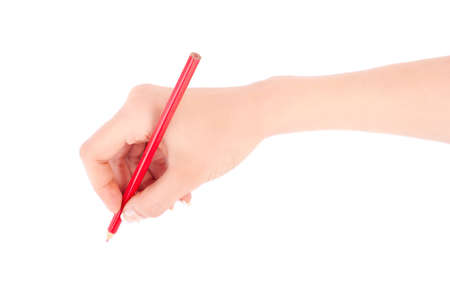 Womans hand holding a red pencil on a white white background  photo
