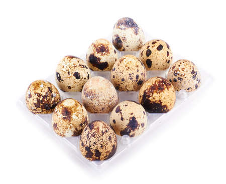 quail eggs in a box isolated on white background  photo